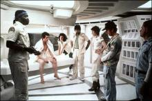 Alien life: Ripley (Sigourney Weaver) leans with concern toward the young monster's host (John Hurt)